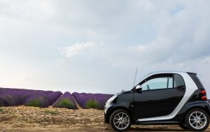Small car at the background of mountains